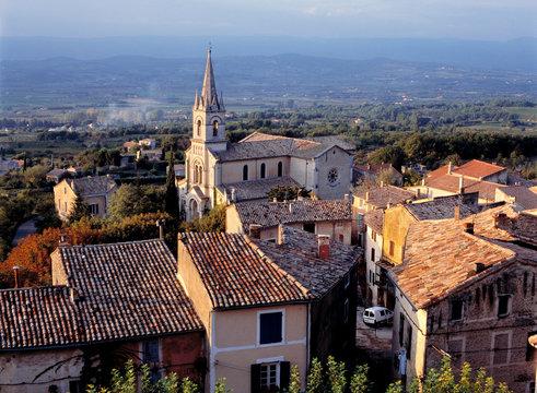 France, Bonnieux. Sunset light falls on the tile roofs of Bonnieux, Provence, France.