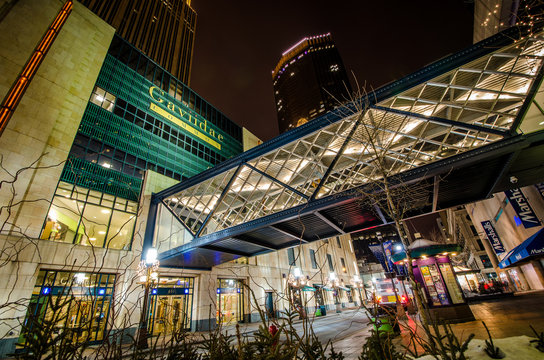 Minneapolis, MN - March 1, 2018 : Exterior view of Gaviidae Common, a downtown Minneapolis shopping mall with skyway access, taken at night