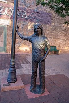 JULY 1 2018 - WINSLOW, AZ: Statue of Glenn Frey from The Eagles - Standin On The Corner in Winslow Arizona along Route 66