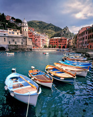 Fotobehang Liguria Italy, Vernazza. Brightly painted boats line the dock at Vernazza Harbor, Cinque Terra, a World Heritage Site, Italy.