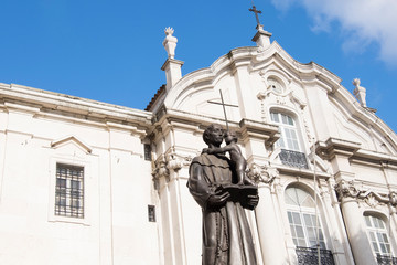 Portugal, Lisbon. St. Anthony of Padua statue in front of St. Anthony Church.