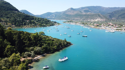 Foto auf AluDibond Karibik Aerial drone bird's eye view photo of iconic port of Nidry or Nydri a safe harbor for sail boats and famous for trips to Meganisi, Skorpios and other Ionian islands, Leflkada island, Ionian, Greece