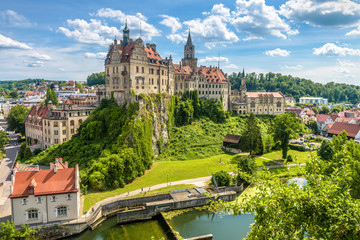 Fototapete - Sigmaringen Castle above Danube river, Baden-Wurttemberg, Germany. This castle is a landmark of Swabia. Beautiful view of old German castle in summer. Scenic panorama of town with castle on cliff.