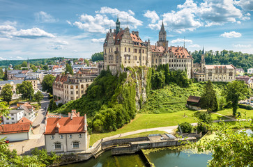 Fototapete - Sigmaringen Castle in summer, Baden-Wurttemberg, Germany. This beautiful castle is a landmark of Swabia. Panorama of town with castle on rock above Danube river. Skyline of old German city.