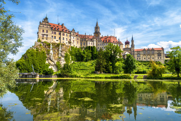 Sigmaringen Castle rising above Danube river, Germany. This beautiful castle is a landmark of...