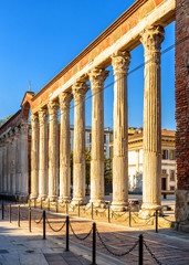 Fototapete - Columns of San Lorenzo, Milan, Italy. It is one of the main tourist attractions of Milan. Ancient Roman ruins in sunset light. Old architecture in the Milan city center in summer.