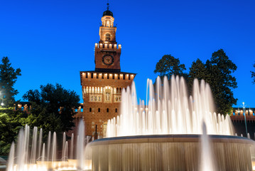 Fototapete - Sforza Castle and beautiful fountain at night, Milan, Italy. This castle was built by Sforza, Duke of Milan. It is a famous landmark of Milan. Old architecture and tourist place in Milan at dusk.