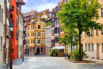 Fototapete - Beautiful street of half timbered buildings in the picturesque Old Town of Nuremberg, Bavaria, Germany