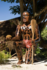 French Polynesia, Moorea. Statue of a Taaroa warrior at Painapo Beach.