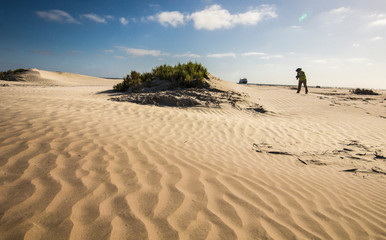 Mexico. Baja, Gulf of California, Magdalena Beach. Photographer taking Pictures on Sand dunes.