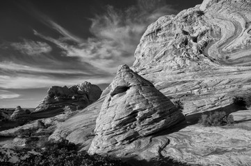 USA, Arizona, Vermillion Cliffs National Monument. Black and white image of sandstone bedding and rock formations with clouds