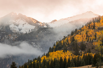 Autumn, aspen trees, mist, and mountain slope at sunrise, from Million Dollar Highway near Crystal Lake, Ouray, Colorado