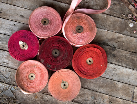 Spools of ribbons have been arranged on the floor of the abandoned Roosevelt sweater Mill in Rockville, CT.