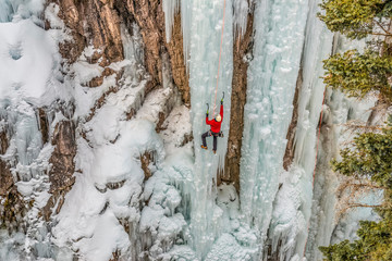 Ice climber ascending at Ouray Ice Park, Colorado