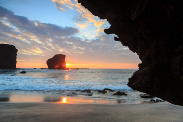 View from beach at Manele Bay of Puu Pehe (Sweetheart Rock) at sunrise, South Shore of Lanai Island, Hawaii, USA