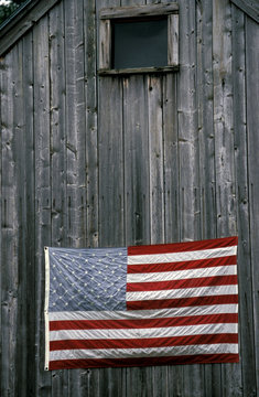 North America, United States, New England. American Flag on barn.