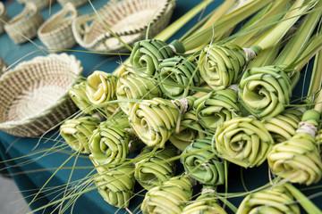 Grass woven roses for sale at market, Charleston, South Carolina. USA