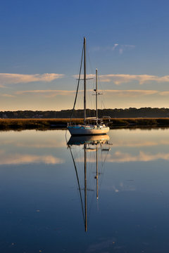 Beaufort, South Carolina. Sailboat with its reflection on the water