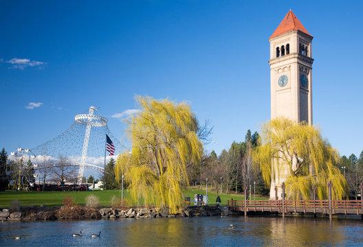 WA, Spokane, Riverfront Park, view across the Spokane River, the Clock Tower and the U.S. Pavilion Entertainment Center