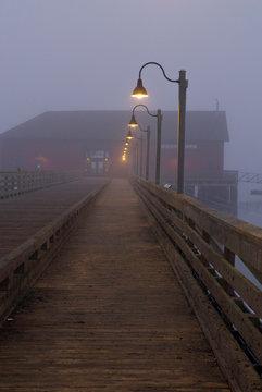 USA, WA, Whidbey Island. Coupeville wharf in fog pre dawn.