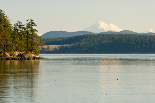 USA, WA, San Juan Islands. View from Pear Point on San Juan Island. Turn Island NWR in foreground, Lopez Island across San Juan Channel, Mt Baker on mainland in distance.