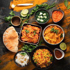Wall Mural - Assorted indian food on black background..