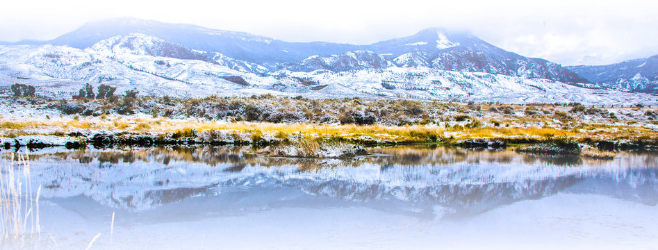 Wapiti Valley, Wyoming. Reflection of mountains in a pond.
