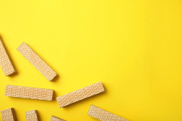 Flat lay composition with delicious crispy wafers on yellow background. Space for text Wall mural