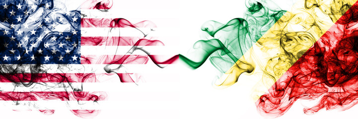 United States of America vs Congo, Congolese smoky mystic flags placed side by side. Thick colored silky abstract smokes banner of America and Congo, Congolese