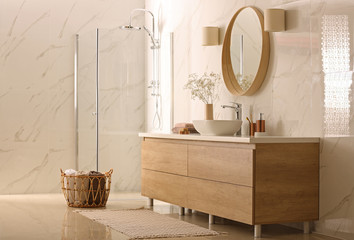 Modern bathroom interior with stylish mirror, vessel sink and glass shower stall Wall mural