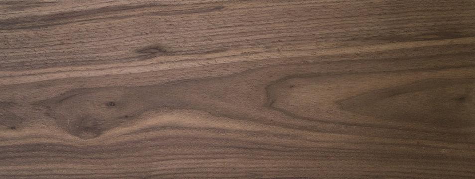 Black walnut wood texture of solid board untreated