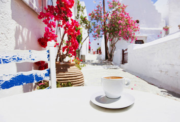 Obraz Traditional greek coffee in a cafe with beautiful mediterranean street on the background - fototapety do salonu