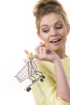 Woman holding small shopping cart