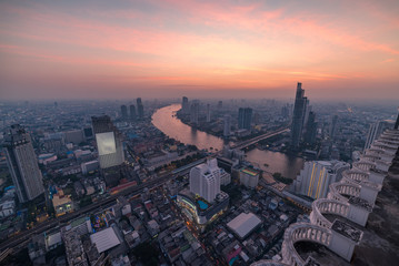 Aerial cityscape at sunset. Bangkok city business centre with skyscrapers