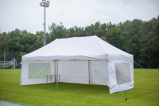 White tent for placing equipment at sports events. SHATER stands at the stadium. Tent for guests.