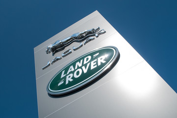 """retail of the logo of the brand """"Jaguar """" and """"Rover"""" the british brand of cars signage on showroom"""