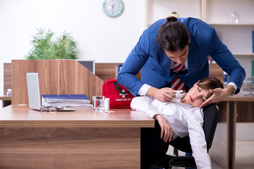 Young employee suffering in the office