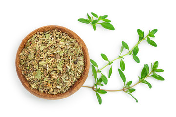 Dried thyme leaves in the wooden bowl, with fresh thyme isolated on white background. Top view