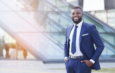Friendly African American Businessman Standing And Smiling In Urban Area Wall mural