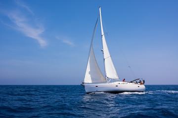 Sailing in the dusk in the Aegean sea, Greece