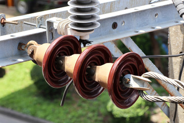 Suspension Type Insulators on Electrical Pole Close up view