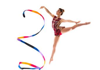Girl doing rhythmic gymnastics with ribbon . jumping