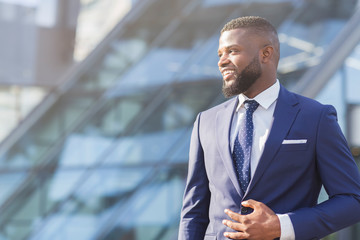 Positive African American Businessman Looking Aside Posing In City