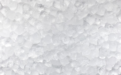 Ice cubes scattered on white for advertisement