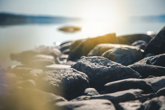 Stones on the shore of the lake, details of nature, soft focus, beautiful landscape