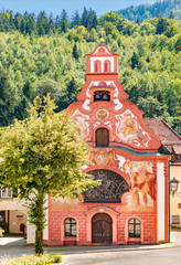 The painted rococo facade of Holy Spirit Hospital Church, Fussen, Bavaria, Germany