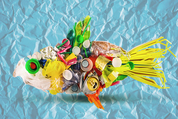 a plastic fish made of disposable and waste plastics, ecology concept