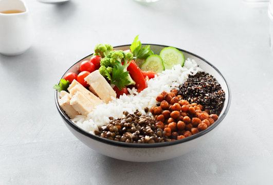 Healthy balanced food concept Buddha bowl with chicken steak, beans and vegetables