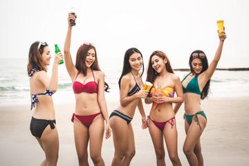Group of woman friends with bikini on beach
