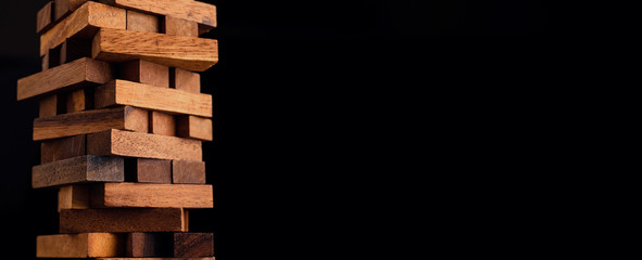 Obraz business organize  management strategy ideas concept wood stack block tower arranging with dark background - fototapety do salonu